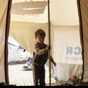 UN agency expanding camps around Mosul to cope with surge in displacement [This three-year-old boy arrived just two days ago at one of UNHCR's camps for displaced families fleeing conflict in West Mosul. Photo: UNHCR/Caroline Gluck]