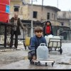 ISIL-s-genocide-against-Yazidis-is-ongoing-UN-rights-panel-says-calling-for-international-action - Syria: UN provides emergency water around Aleppo, as 1.8 million cut off from water supply [In east Aleppo City, Syria, boys and a man collect water from a UNICEF-supported water point in Shakoor neighbourhood. Photo: UNICEF/Khuder Al-Issa]